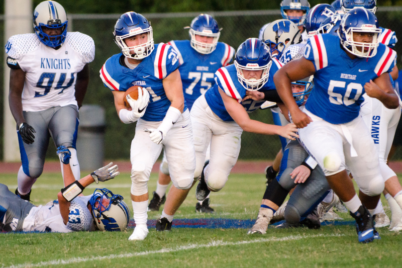 Heritage senior Hunt Thomas finds running room during a scoring drive in the first half.