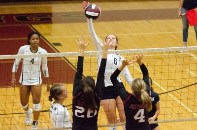 Newnan senior Anna Marie Campbell reaches for a strike at the net against Northgate.