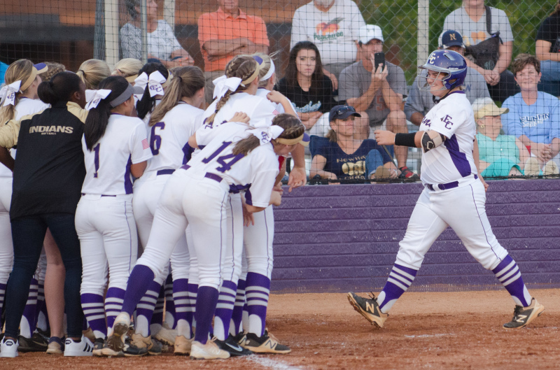 Ansley Gunter smiles while being greeted by teammates following her two run homer in the second.