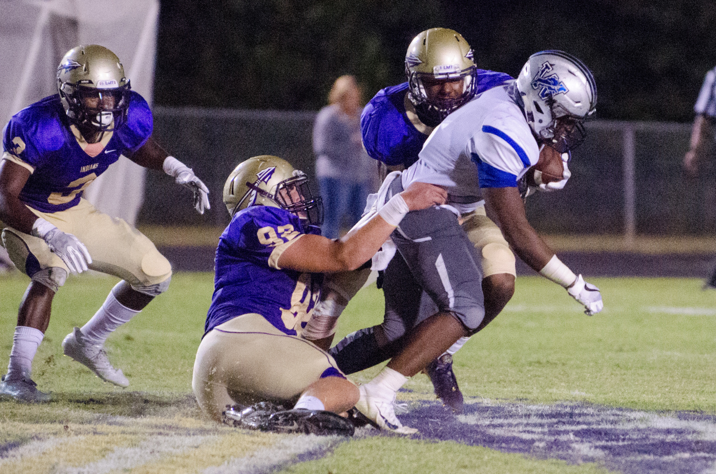 Defensive lineman Clay Patterson grabs a hold of a Westlake running back.
