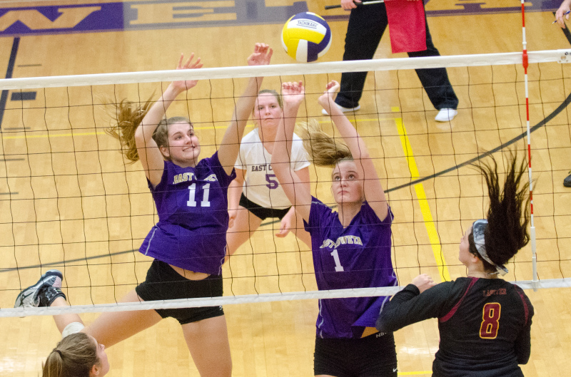 Senior Allie Edwards and junior Becca Sieckmann combine for a block at the net against Lassiter.