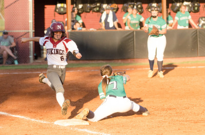 Audrey Baxter is unable to leg out a single following a stretch by Harrison's Emma Bookout.