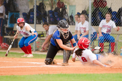 Heritage runner Rachel Henson is cut short at home plate by a tag while trying to score in Game 2.
