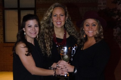 Northgate coaches Sarah Frazier, Jori Young and Taylor Swinney with this year's state trophy.