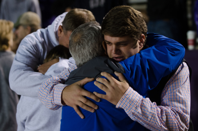 Newnan senior Garrison Morgan hugs Coweta FCA leader Brian Morgan at the close of Thursday's rally.