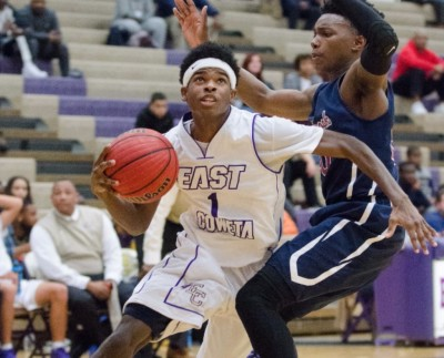 East Coweta senior Jamal Kennedy drives to the basket in the second half of Tuesday's game at home.