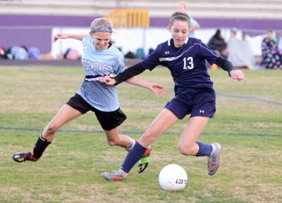 Lee's Lauryn Fetherston and Evans' Molly Anderson battle for possession in the first half.