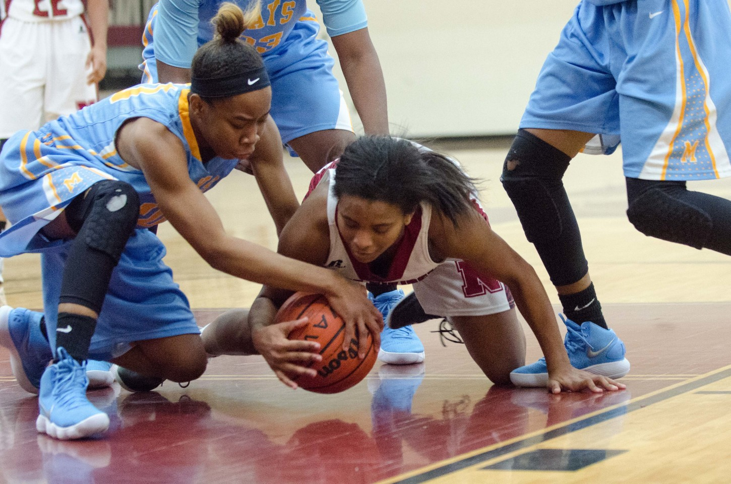 Northgate senior Leia Robinson dives for a loose ball in front of Mays' basket.