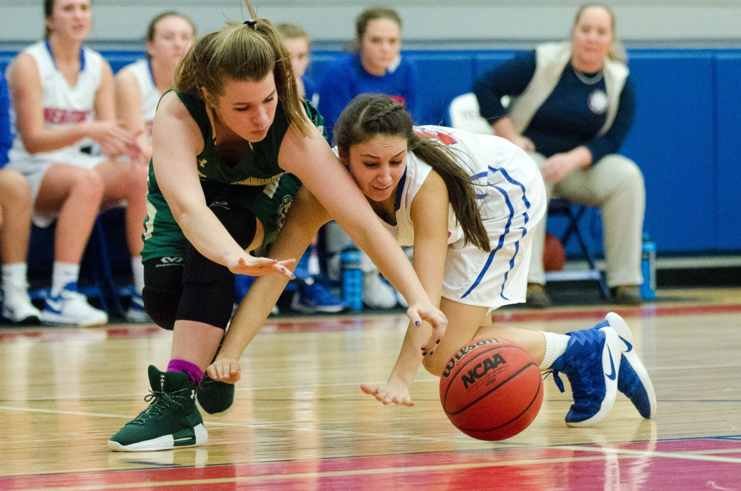 Heritage School's Tricia Underwood battles for a loose ball in the second half.
