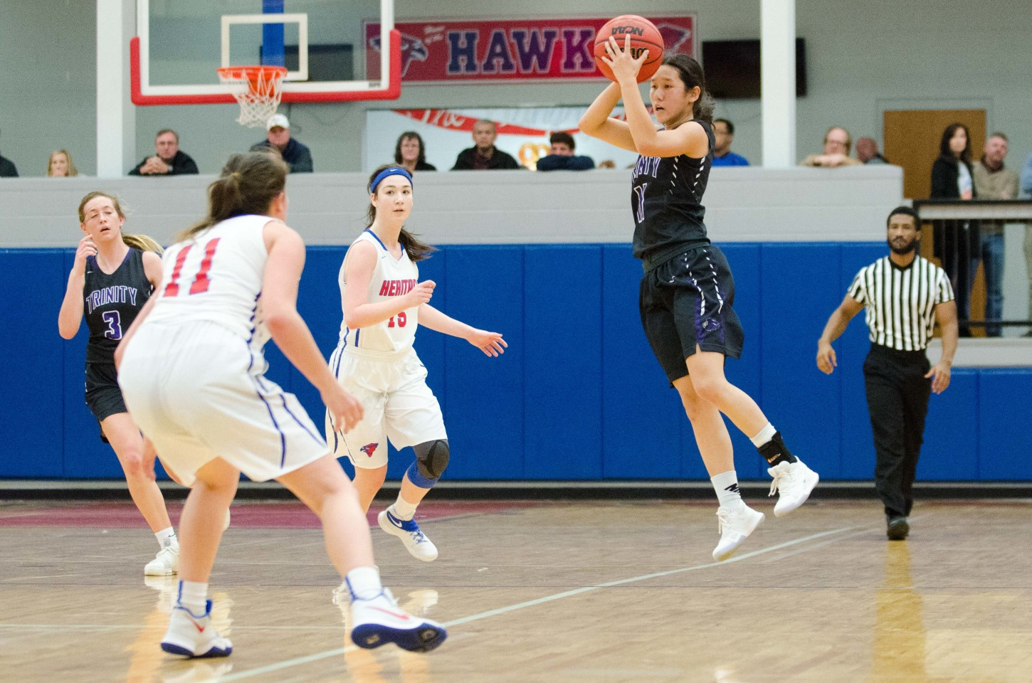 Trinity's Anna Montgomery grabs a pass out of the air while looking upcourt for a teammate.