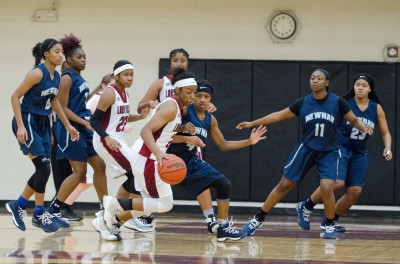 Newnan's Shynia Patterson keeps an eye on Northgate's Chasdhe Godfrey