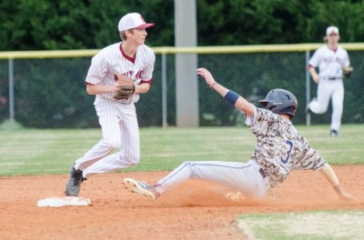 Northgate shortstop Will Queen forces out Newnan runner Hamilton Schubert at second base.