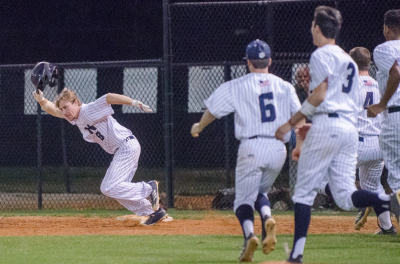 Newnan senior Trip Fallon takes off after reaching first with a game-winning walk in a 7-6 comeback.