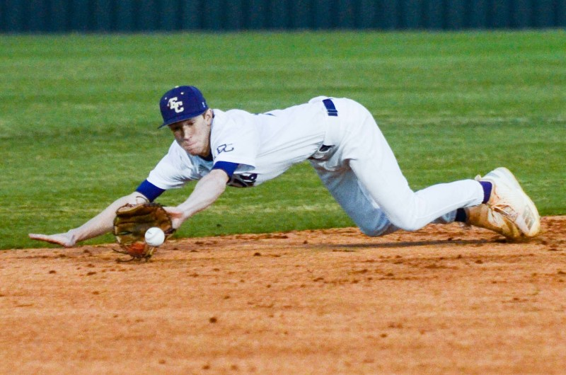 Shortstop Caleb Cashion eyes a groundball into his glove that went for an infield single.