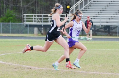 Northgate's Sydney Tuttle and East Coweta's Caitlyn Moore shadow each other running upfield.