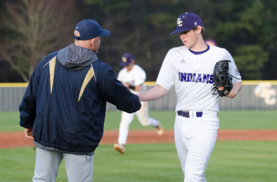 Austin Bunn is congratulated by Wheeler head coach Mark Collins after his complete-game effort.