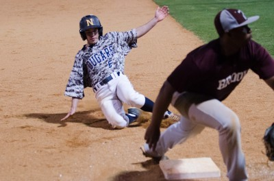 Mason McKibbon slides into third during Game 2 against Pebblebrook