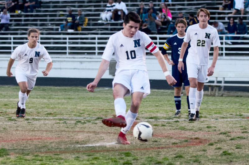 Newnan senior Alex Glomba connects on a successful penalty shot for the Cougars' second goal.