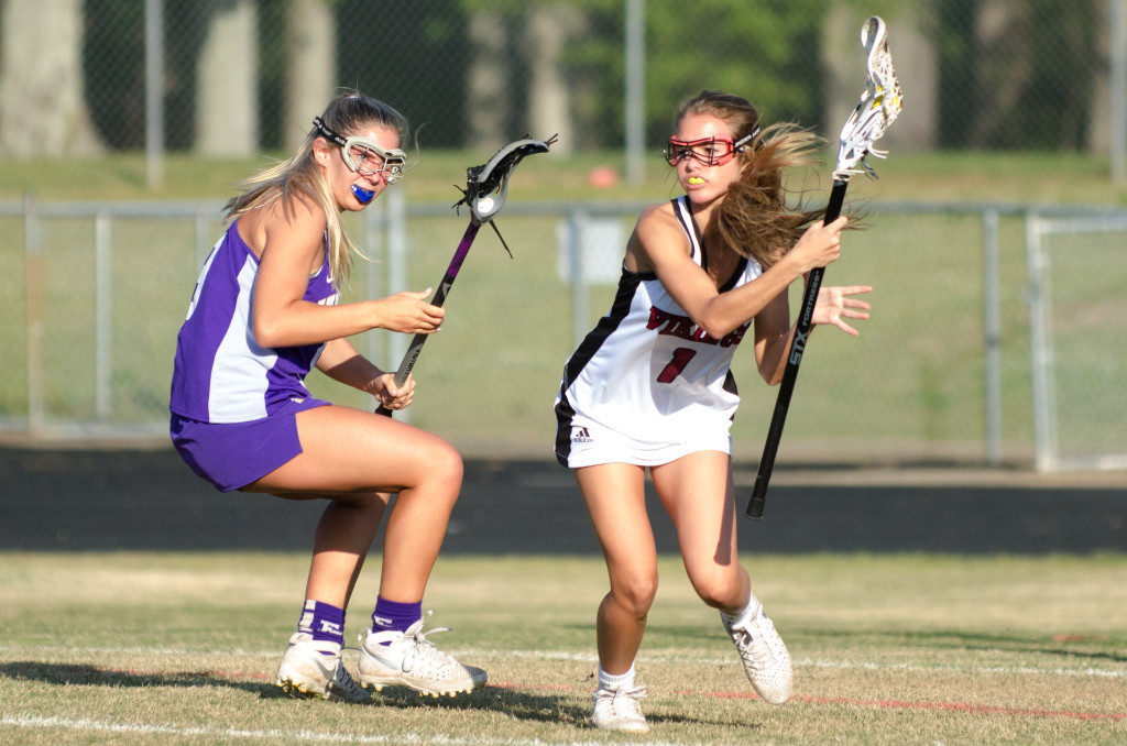 Northgate senior Tina Sierra changes direction while trying to elude ECHS defender Hanna Miller