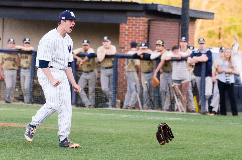 Logan Hudson rejoices after a strikeout closed a 4-0 win over Wheeler and a region title