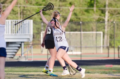 Newnan senior Mallory Williams raises her arms after scoring with 4 seconds left.
