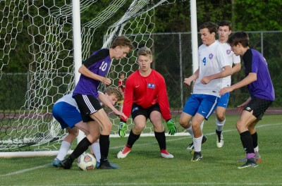 Jack Hunt protects the Heritage net on a Trinity scoring chance in the second half.