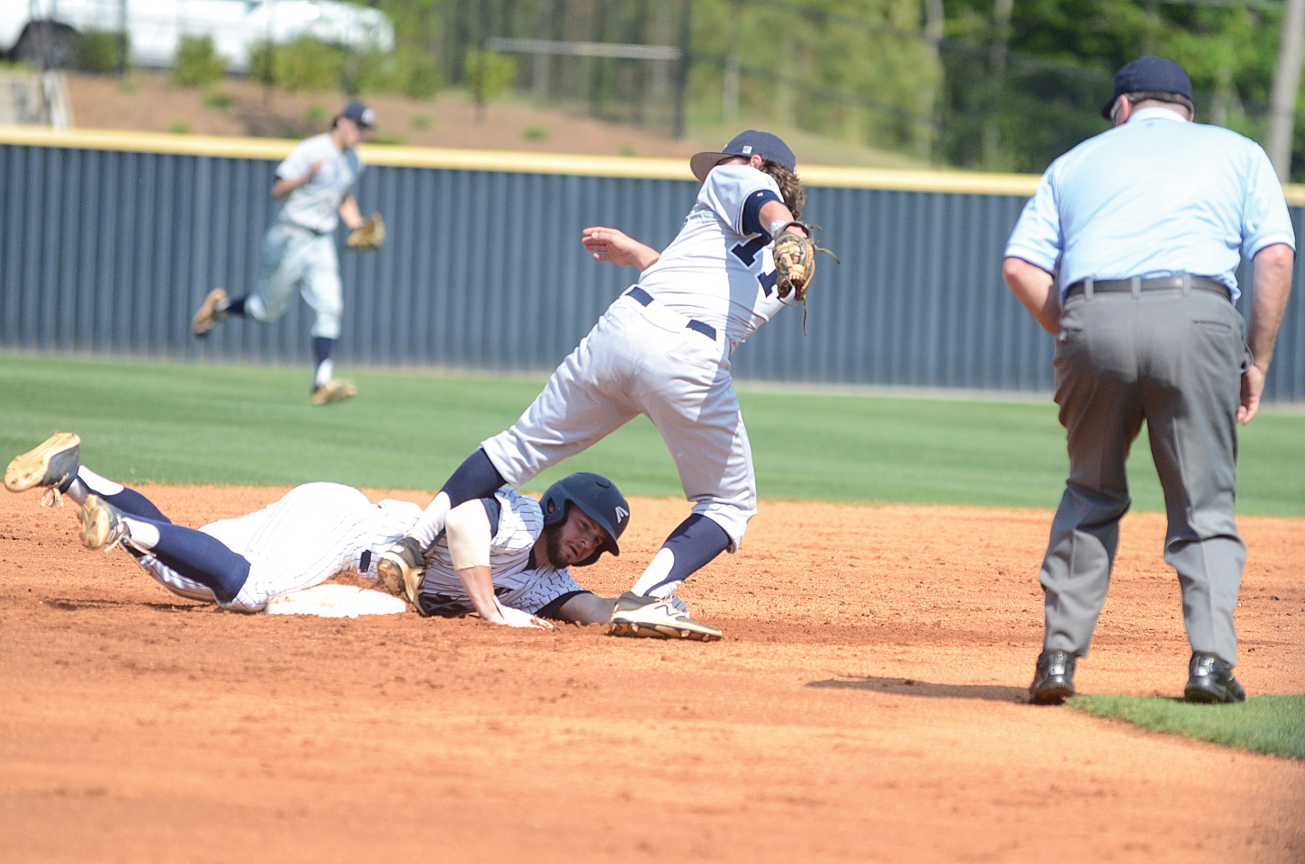 Will Wilbanks looks for a call after sliding into second during a hit-and-run attempt in Game 1.