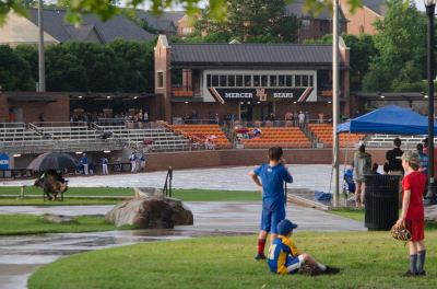 The tarp at Mercer's Claude Smith Field stayed in place for nearly four hours on Friday.
