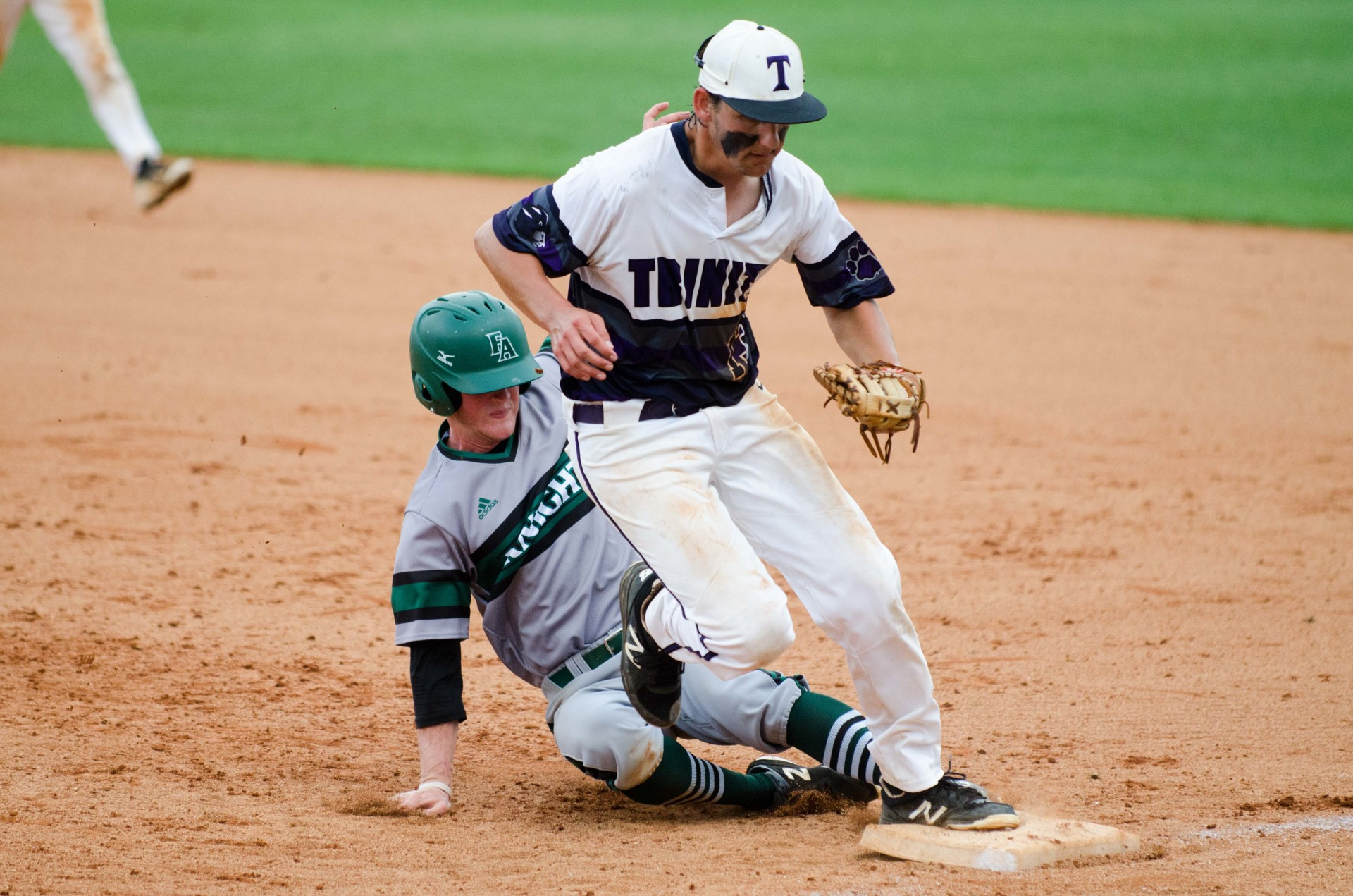 Trinity senior first baseman Jake Estes beats out Frederica's Chandler Kicklighter for a double play