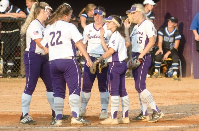 East Coweta's infield huddles in the circle during Monday's game against Locust Grove.