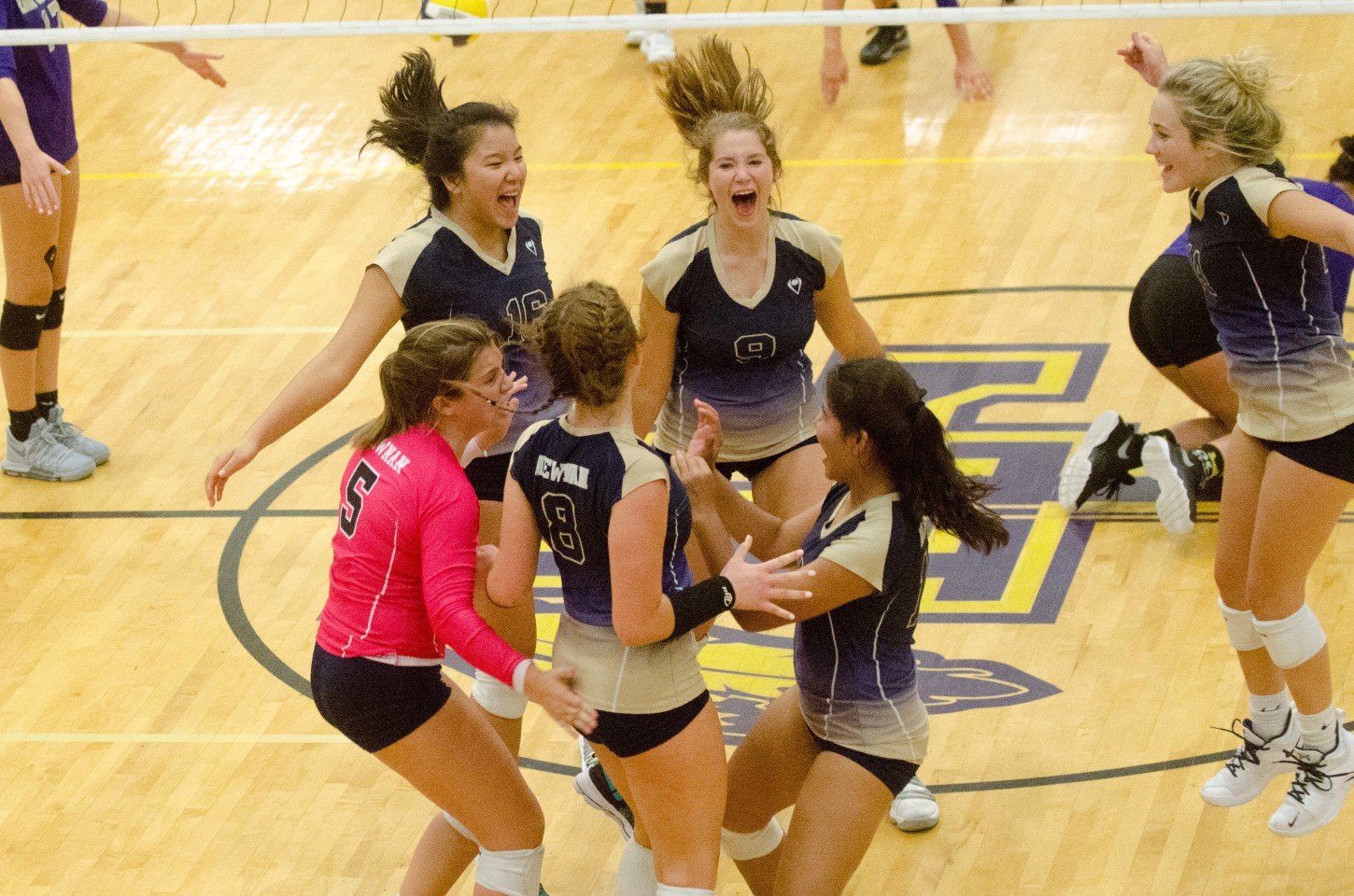 Newnan's JV celebrates the final point of a hard-fought sweep of host East Coweta.