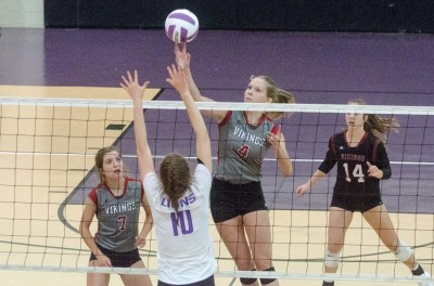 Northgate senior Kaela Busby tries to lift a kill attempt over  Trinity's Savannah Poling.