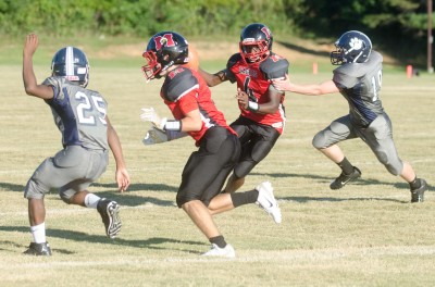James Paige ran for two scores, including one here, and also had a touchdown pass in a 27-8 win.