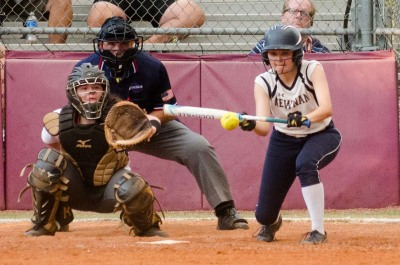 Newnan senior Hailee Hartfree drops a bunt that scored a runner from third in a win over Northgate.