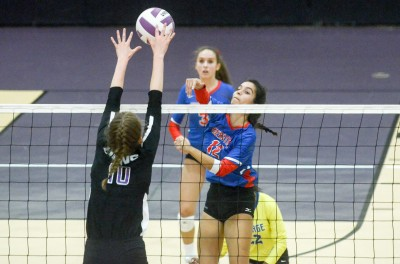 Heritage's Andrea Caceres battles Trinity's Savannah Poling at the net in Thursday's match.