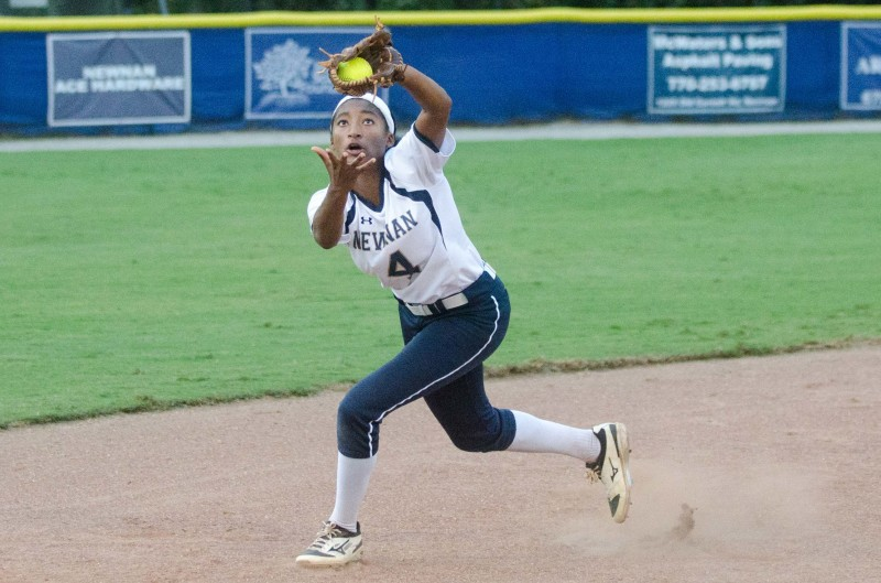Newnan shortstop K.K. Madrey tracks down an infield fly during Game 1 prior to a weather delay.
