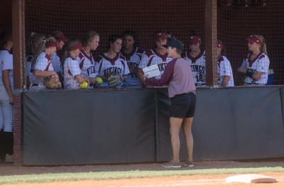Northgate head coach Lisa Skelton talks with her team during its first-round playoff sweep.