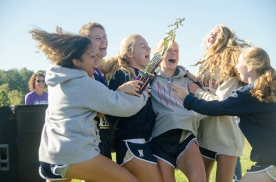 Newnan's varsity girls celebrate a one-point victory that also helped capture the Coweta Cup trophy.