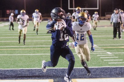 Newnan senior receiver Woody Waters hauls in a 24-yard touchdown pass in the first quarter.