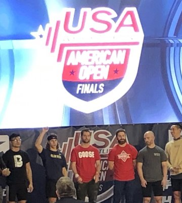 Dean Goad Jr., second from left, was the youngest lifter in the 73kg division.