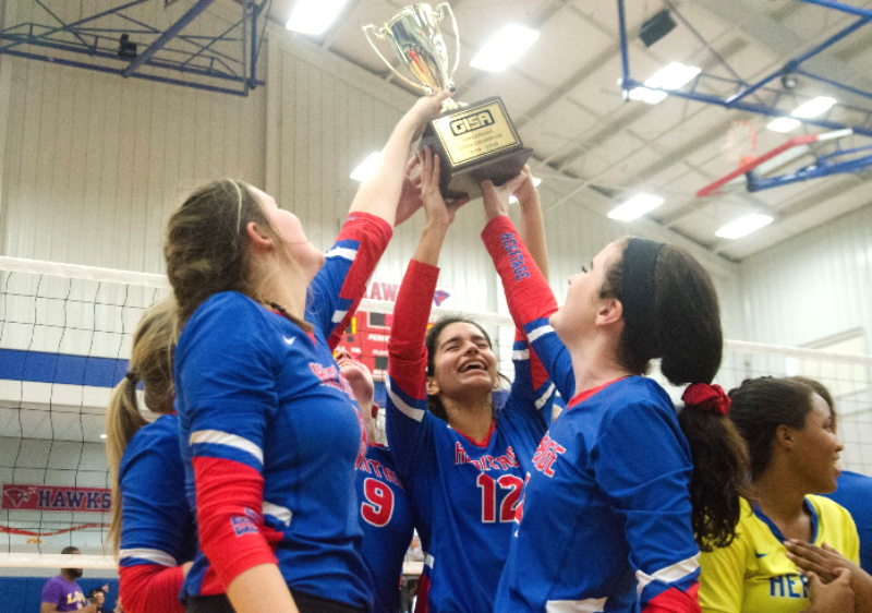 Heritage School's volleyball team hoists another GISA championship trophy after beating Valwood.
