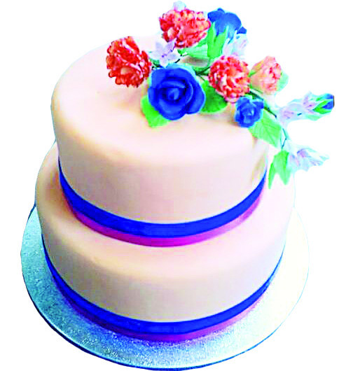 Two tiered cake with handmade edible flowers.