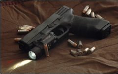 Figure 11 - Modern Glock 22 with pistol light & custom grip