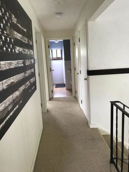 Upper Level Hallway leads to 3 bedrooms and full bath.