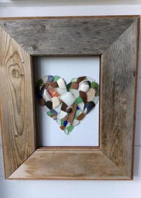 Reclaimed barnwood frame and sea glass heart design