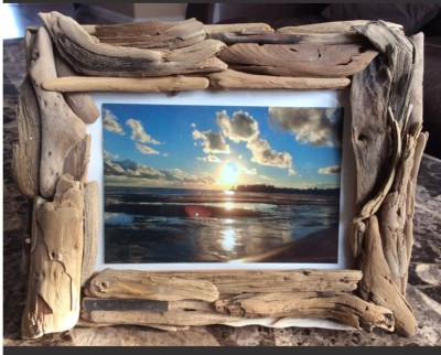 Driftwood frame with photo of PEI beach sunset