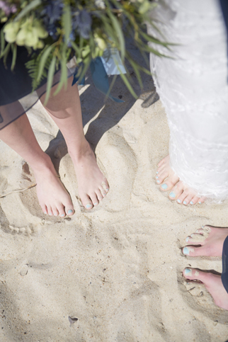 painted toes in sand