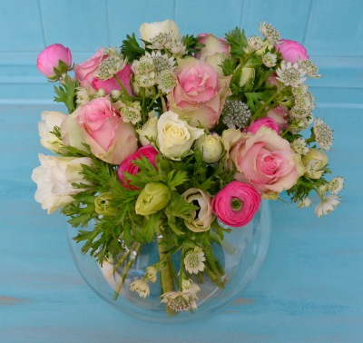 Spring flowers for Mother's Day in this hand tied bouquet in glass fishbowl.