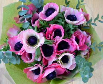 Pretty hand tied bouquet of pink anemones, also available in red, white and blue.