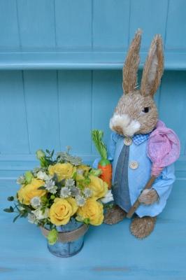 Peter Rabbit and Seasonal Bucket of Easter Flowers.